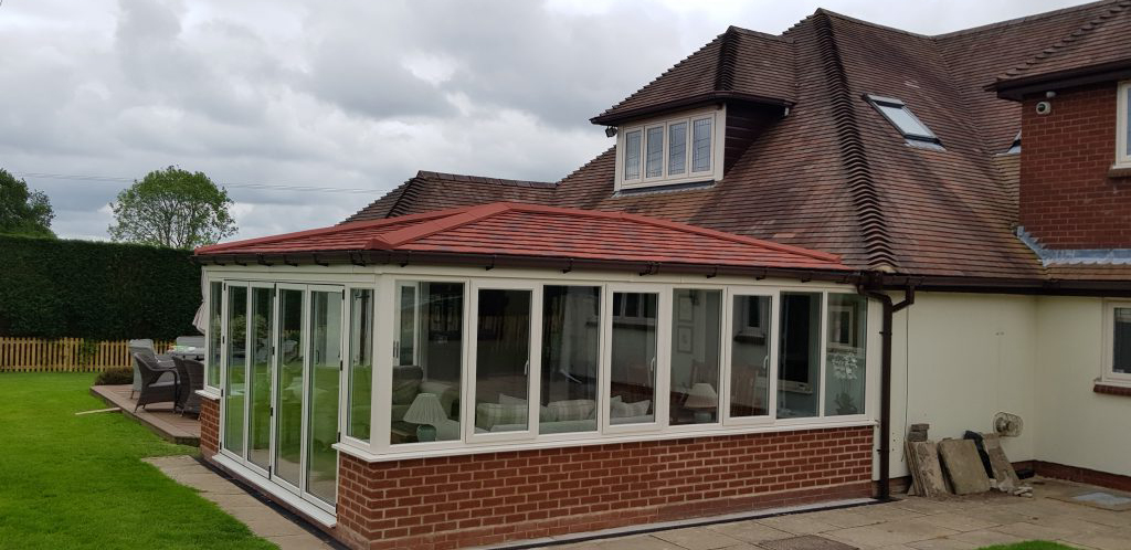 Tile Effect Roof and White UPVC Windows & Doors
