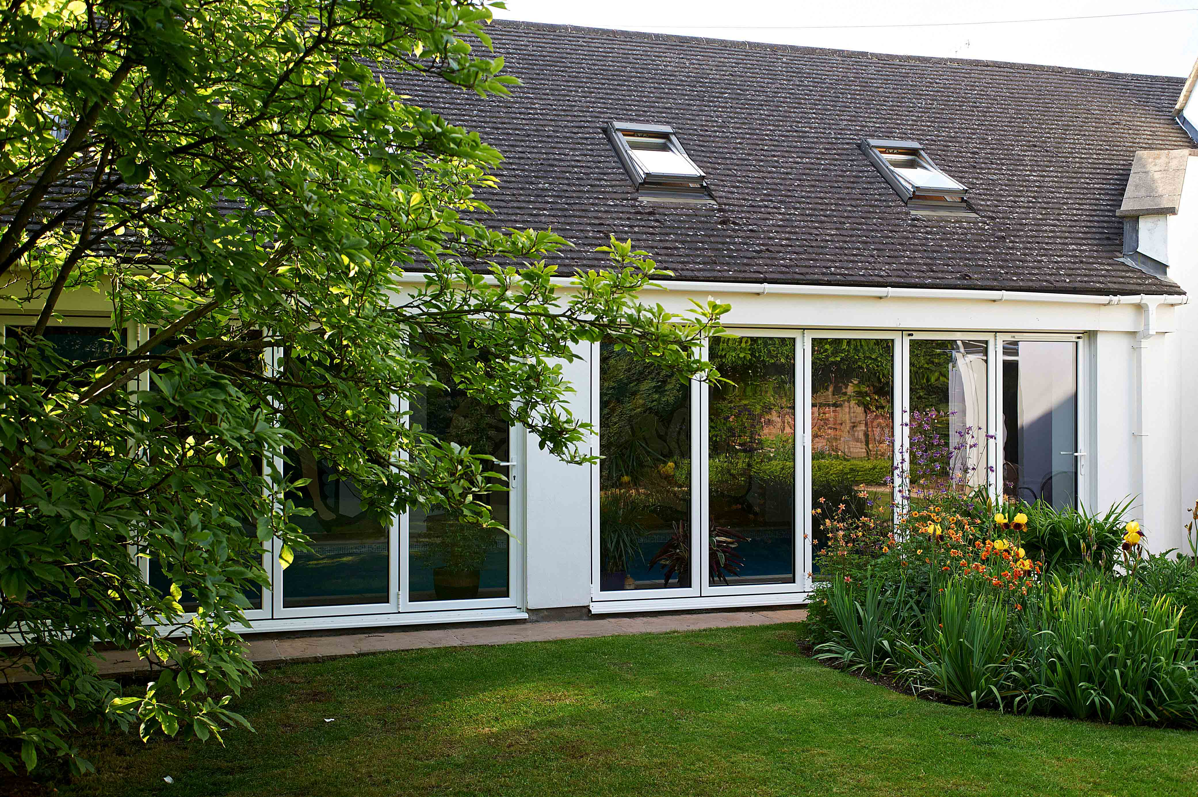 White Bi-Fold Doors and Skylights