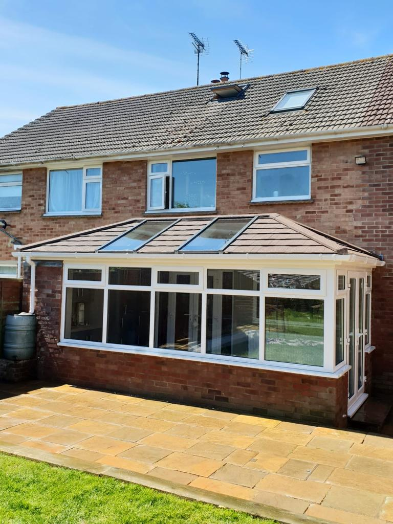 Tile Effect Roof, Skylights, Conservatory and White UPVC Windows & Doors
