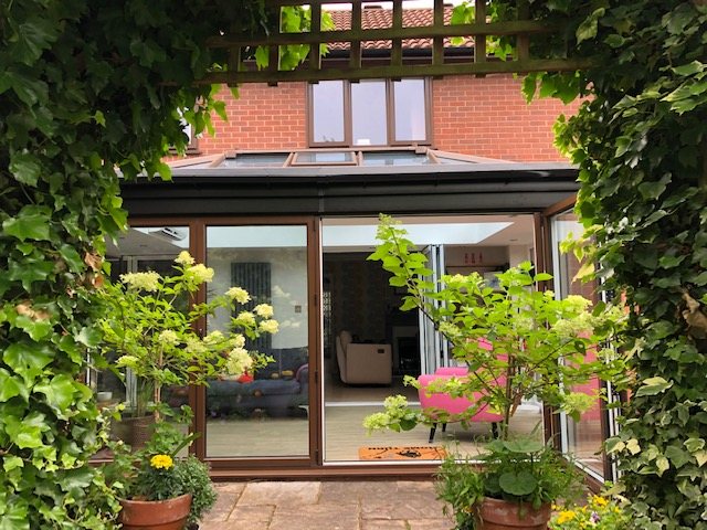 Bi-Fold Doors and Orangery in Brown