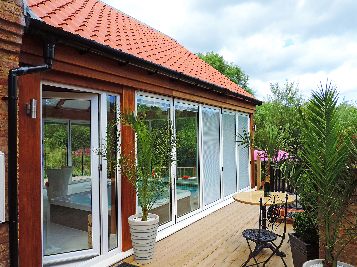 White Bi-Fold Doors and Tile Effect Roof